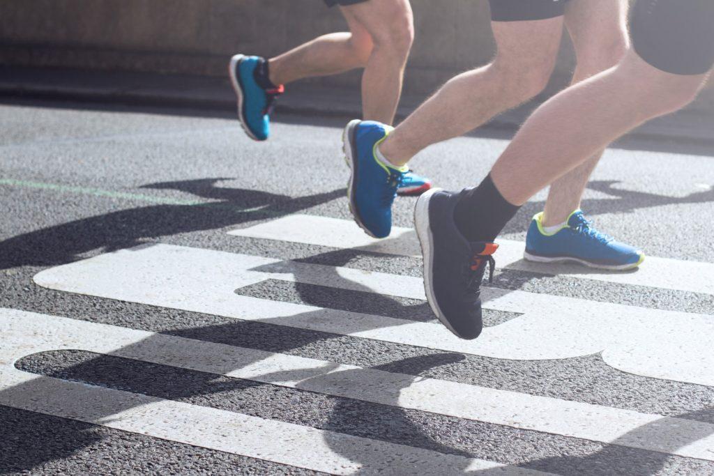 synchronized legs of marathon runners